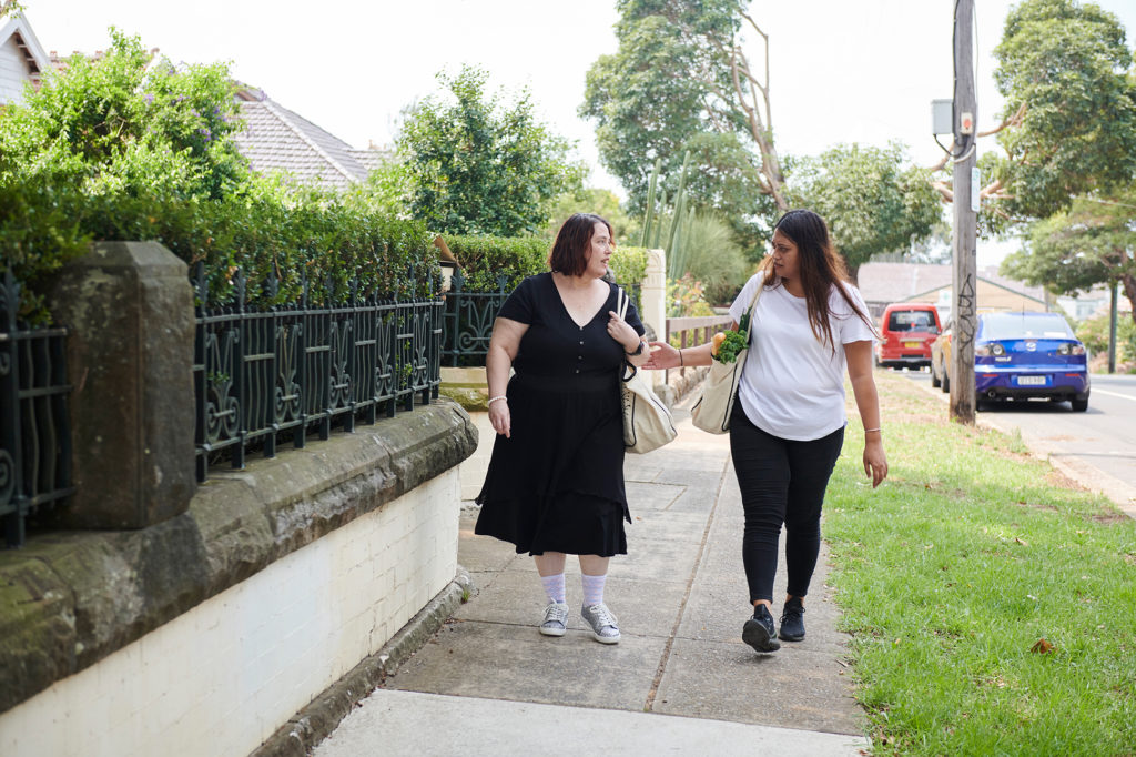 women talking in street