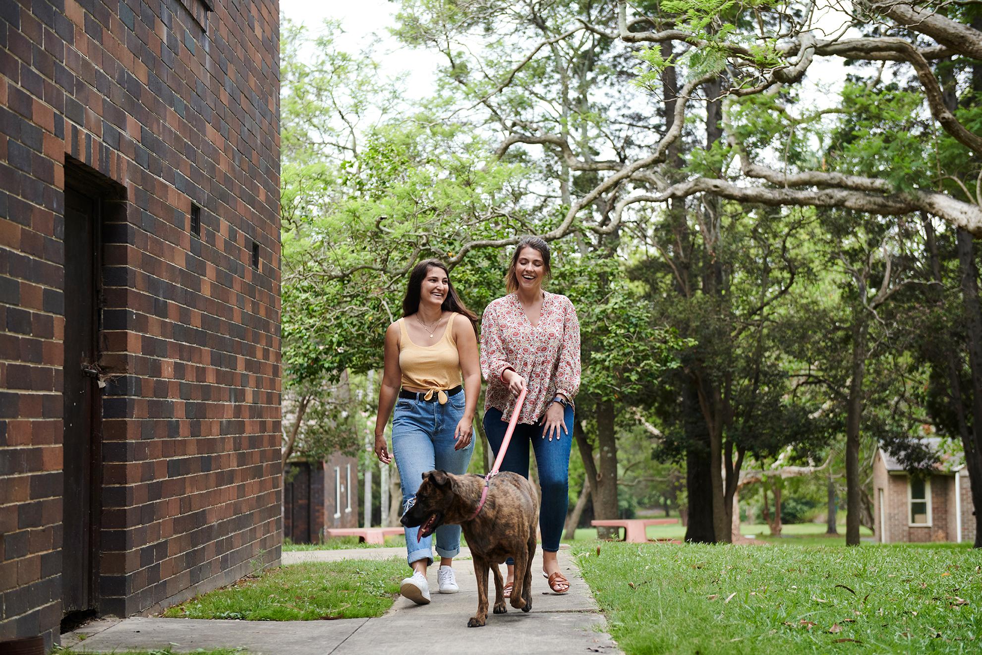 young women walking a dog