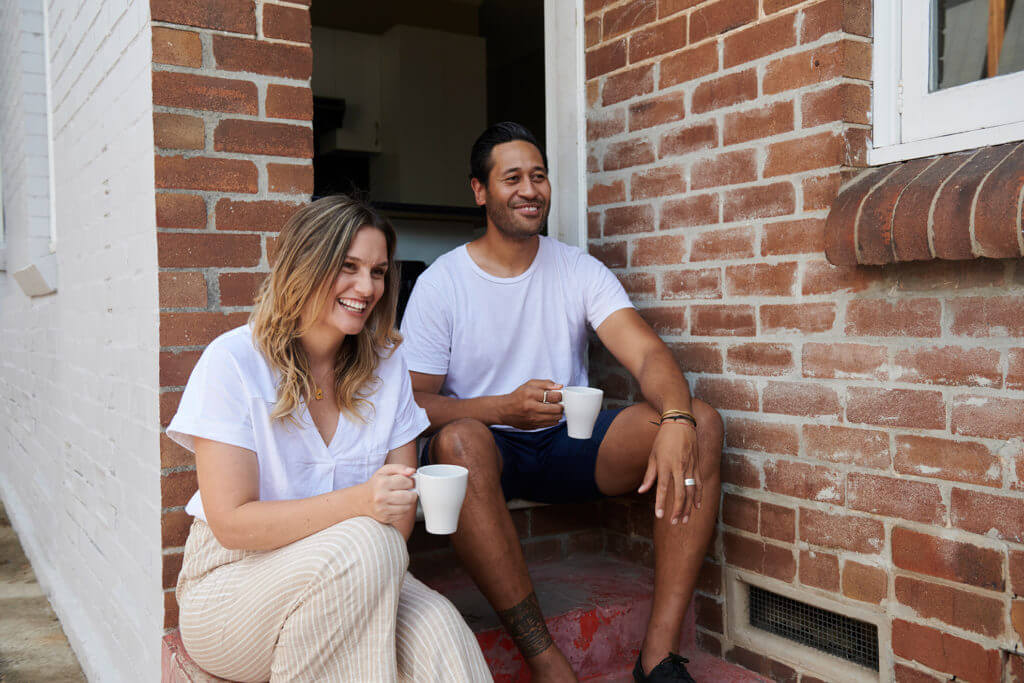 Woman and man drinking tea outside