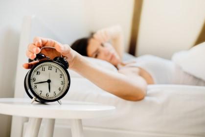 girl sleeping and alarm clock