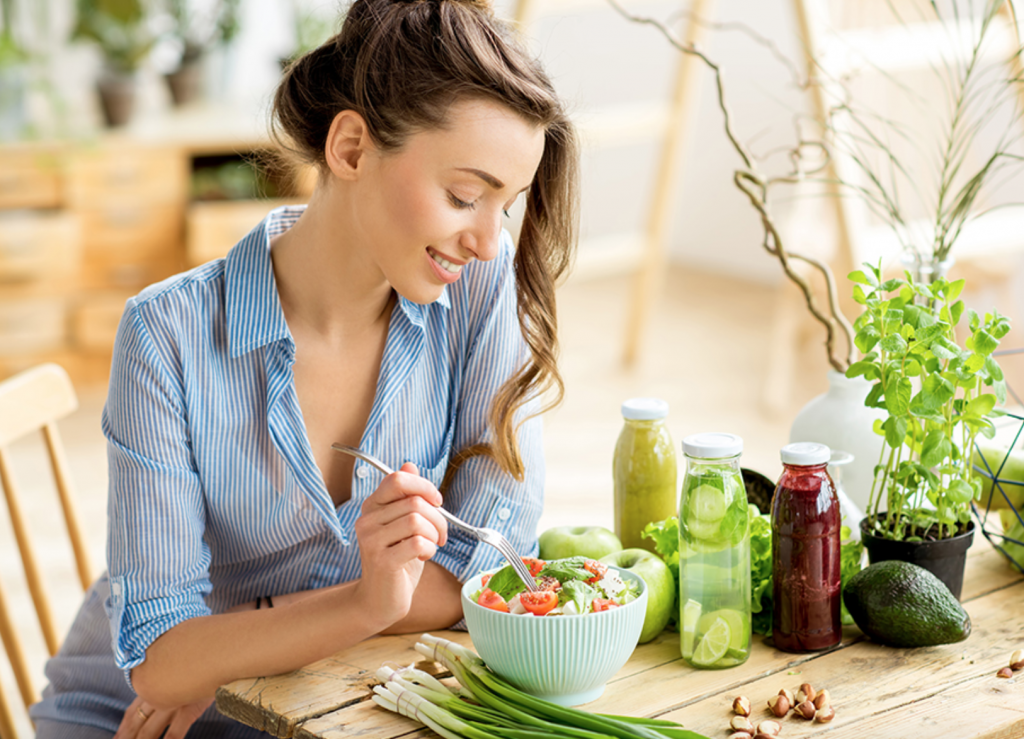 woman maintaining mental and physical health by eating healthy
