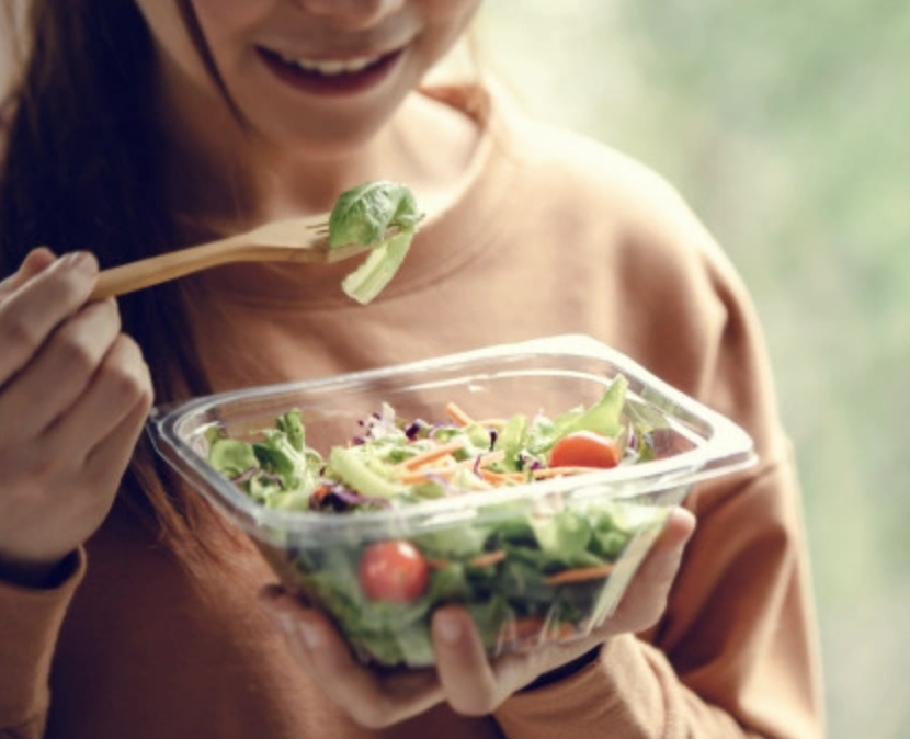 woman eating salad to negate depression and anxiety