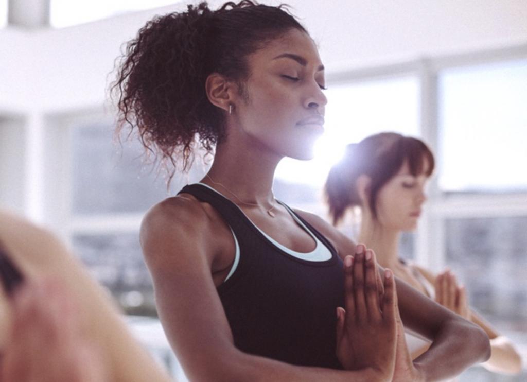 woman practicing self care through yoga