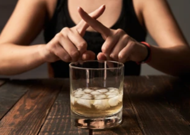 person avoiding alcohol consumption to avoid impacting mental health
